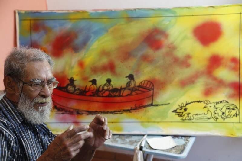 Ilton Silva estudando o uso do spray de grafite em suas telas (Fotos: Gerson Walber)