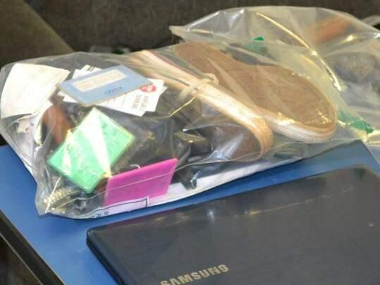 Objetos da vítima foram encontrados na casa de Luis.  (Foto: divulgação/Polícia Civil)