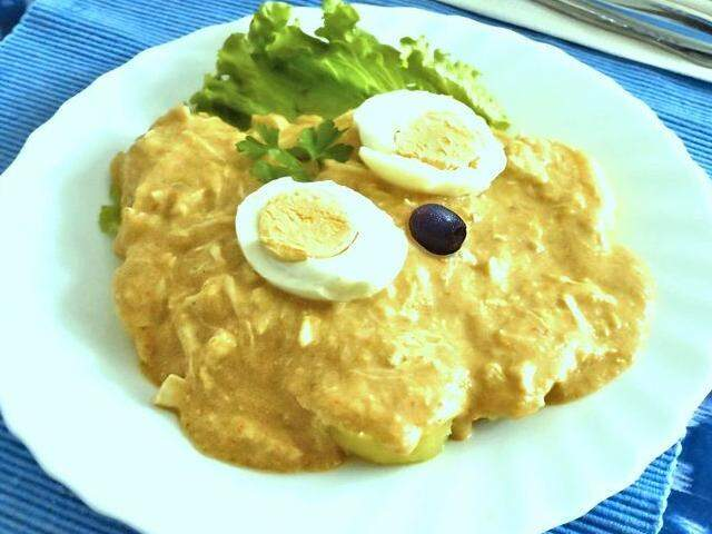 """""""Aji de galinha"""", em português """"picante de galinha"""", prato peruano feito por José. (Foto: Arquivo pessoal)"""