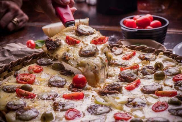 Delícias da Pedaço da Pizza chegam em casa de segunda a segunda. (Foto: Divulgação)