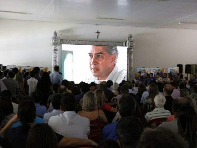 Vídeo sobre a história de Reinaldo Azambuja foi apresentado na abertura do encontro (Foto: Helio de Freitas)
