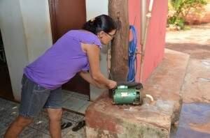 Algumas famílias ainda usam o poço artesiano em casa (Foto: Arquivo/ Campo Grande News)