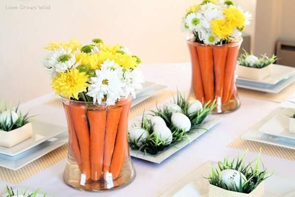 As cenouras e as flores lembram o maior símbolo da Páscoa.