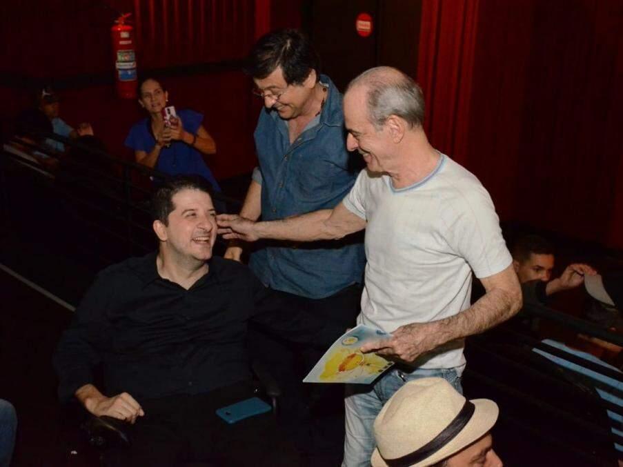 Ricardo Câmara, Joel Pizzini e Ney Matogrosso durante pré-estreia. (Foto: Toninho Souza)