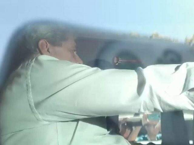 Puccinelli na viatura do PF (Polícia Federal), quando foi preso na sexta-feira, dia 20 de julho (Foto: Reprodução)