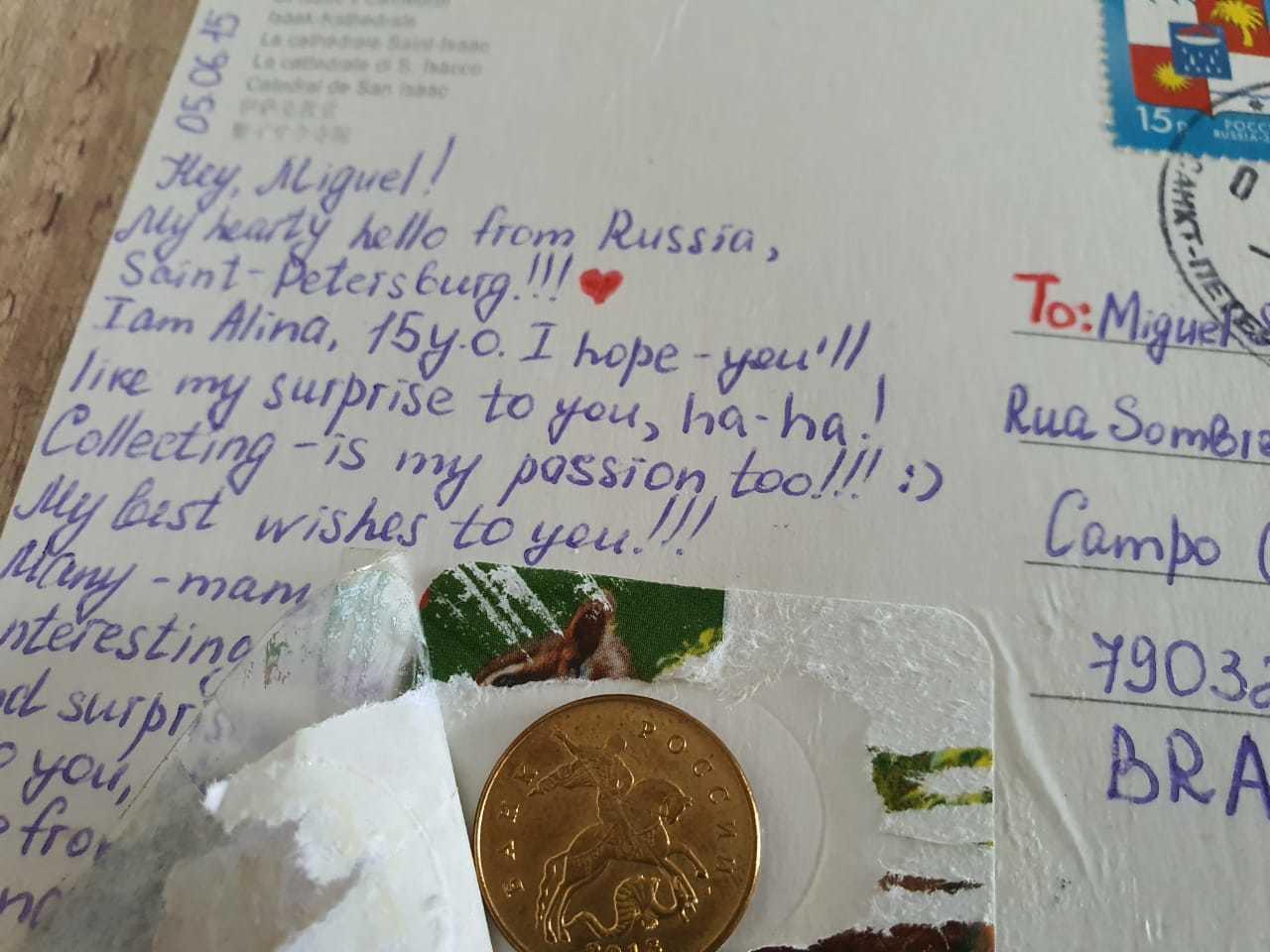 Cartinha e moeda que veio da Rússia (Foto: Arquivo Pessoal)